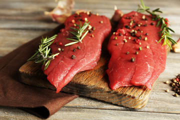 Raw beef steak with rosemary and spices