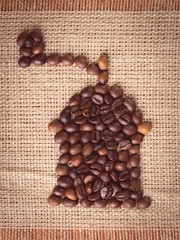 Image of manual coffee grinder made with coffee beans
