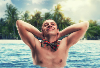 Confident young man in the sea