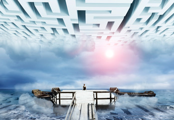Woman sitting on an old pier in the maze