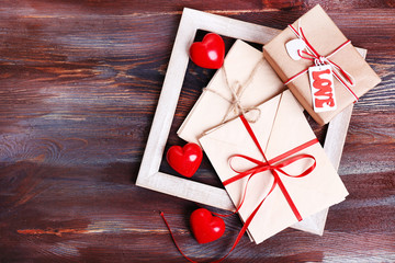 Love letters with gift on wooden background
