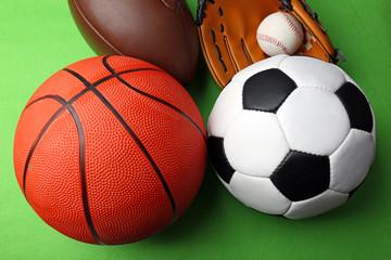 Sports balls on green background