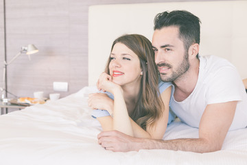 Young couple embraced on the bed