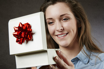 Close up of beautiful woman with gift