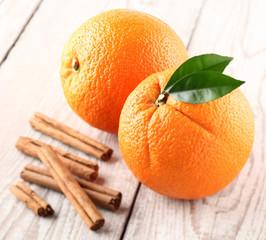 Orange fruit with cinnamon sticks