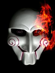 Halloween plastic mask on fire