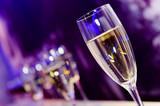 Champagne glass in nightclub neon lilac, blue, purple lights