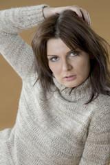 Brunette girl in a warm wool sweater..