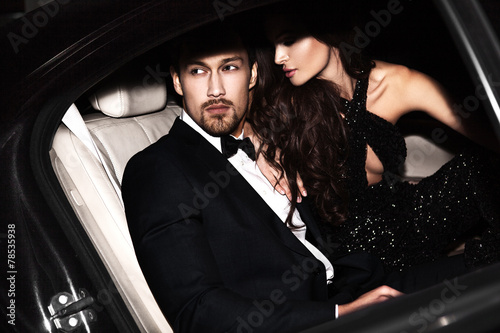 Sexy couple in the car. Hollywood stars. - 78535938