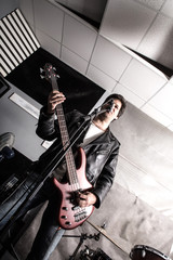 Rock singer playing bass in the rehearsal Studio