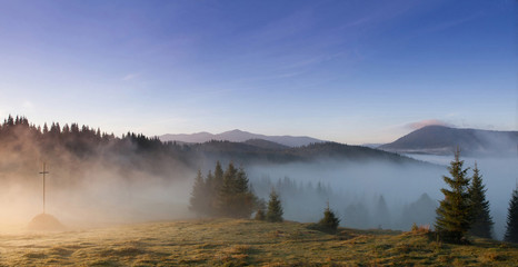 Fog on a hill in Carpathian mountains