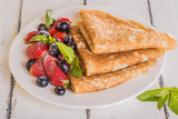 Homemade crepes with berries and fruit - 78537305