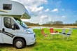 RV (camper) in camping, family vacation travel in motorhome - 78537508