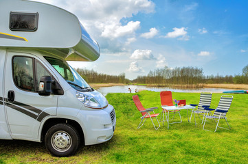 RV (camper) in camping, family vacation travel in motorhome