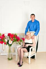 Elegant pregnant couple
