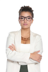 Portrait of businesswoman standing with crossed arms