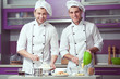 Leinwanddruck Bild - Tiramisu cooking concept. Portrait of two smiling men
