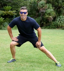 Athletic Young Man Doing Exercises