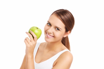 Pretty woman holding green apple