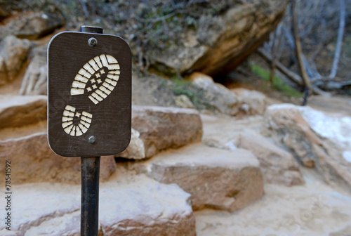 Hiking boot sign on trail - 78541592