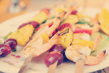 Prawns grilled with fruits, toned