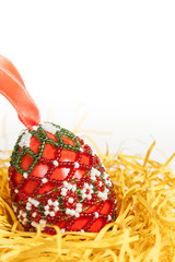 red easter egg decorated with beads