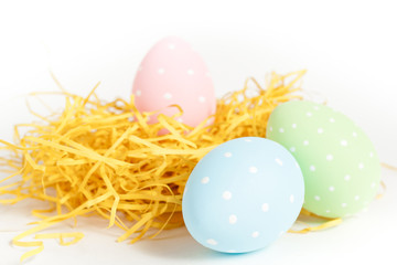 dotted easter eggs in a nest