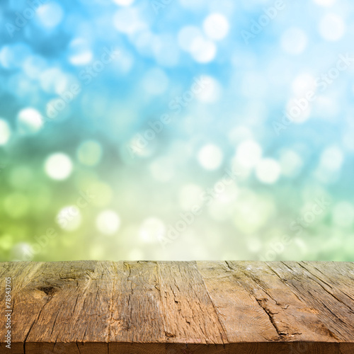 canvas print picture Table with bokeh background