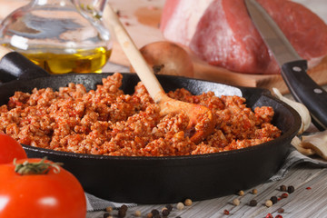 sauce Bolognese in a pan and ingredients closeup horizontal