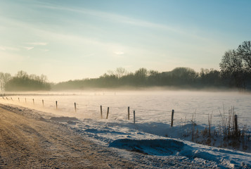 Misty rural landscape in wintertime