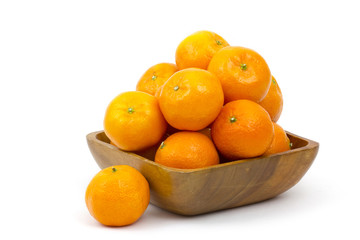 tangerines in a bowl on white background
