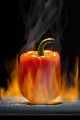 Orange Pepper on a Hot Flaming Barbecue Grill