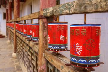 Religious red prayer wheels