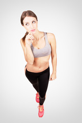 Confident young sporty woman posing