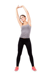 Sporty fit woman stretching arms and back