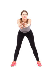 Young sporty woman stretching arms front
