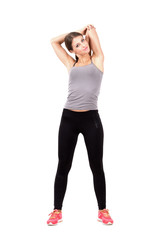 Woman stretching triceps over her head