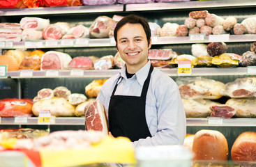 Butcher in his supermarket