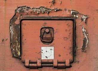 Cracked paint on rusty iron
