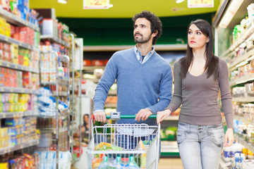 Young couple shopping at the supermarket