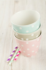polka dot cups on wooden surface
