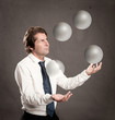 businessman juggling with crystal sphere balls