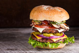 Double patty hamburger with a variety of ingredients