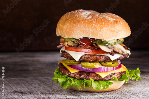 Double patty hamburger with a variety of ingredients - 78548968