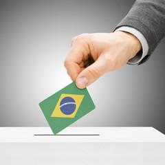 Voting concept - Male inserting flag into ballot box - Brazil
