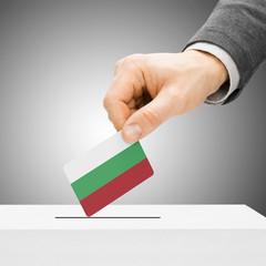 Voting concept - Male inserting flag into ballot box - Bulgaria