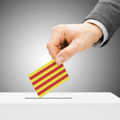 Voting concept - Male inserting flag into ballot box - Catalonia