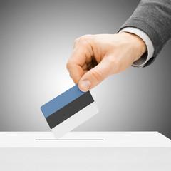Voting concept - Male inserting flag into ballot box - Estonia