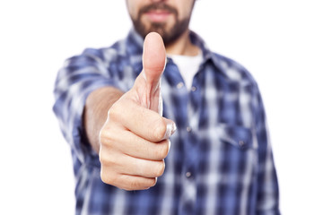 Casual man giving thumbs up sign, isolated on white background