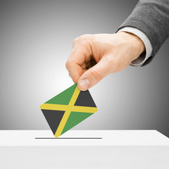 Voting concept - Male inserting flag into ballot box - Jamaica